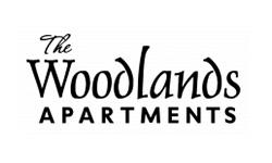 Woodlands Apartments Logo
